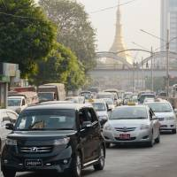 Last frontier: Cars stream through Yangon on Jan. 28. | KYODO