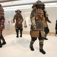 Full suits of colorful samurai armor are displayed at the Kimbell Art Museum in Fort Worth, Texas, on Feb. 13. | AP
