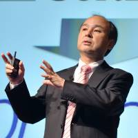 Hard beginning: SoftBank Corp. founder and President Masayoshi Son announces the company's financial results at a press briefing in Tokyo on Wednesday. | AFP-JIJI