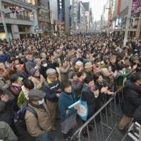 Mass appeal: A large audience gathers in front of the Mitsukoshi Department Store in Tokyo's Ginza shopping district as a candidate for governor makes a speech Sunday, one week ahead of the election. | KYODO