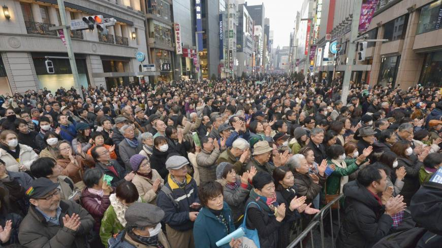 Mass appeal: A large audience gathers in front of the Mitsukoshi Department Store in Tokyo's Ginza shopping district as a candidate for governor makes a speech Sunday, one week ahead of the election.