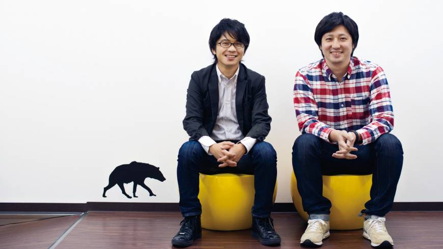 Takuma Kobayashi (left), the president of cloud funding firm Search Field Inc., and board member Ryuta Saito pose for a photo at the company's office in Shibuya Ward, Tokyo.