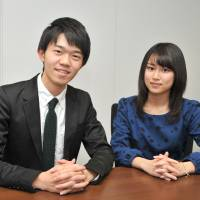 Takatoki Morino (left) and Ayaka Machida try to engage teens in politics through their group Teen's Rights Movement. | YOSHIAKI MIURA