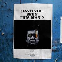 A wanted poster of fugitive President Viktor Yanukovych hangs in central Kiev on Thursday. | AP