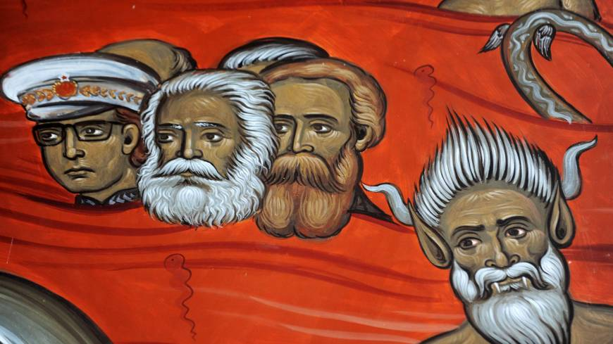 Red devils: This detail from a fresco of sinners in hell at the new Church of Christ's Resurrection in Podgorica shows a demon below German communist philosophers Karl Marx (center) and Friedrich Engels (right) and Yugoslav communist leader Josip Broz Tito.