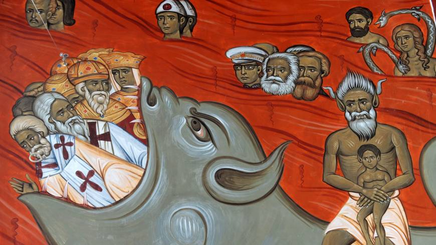 To each according to his need: This fresco of hell in the new Church of Christ's Resurrection in Podgorica shows the grouped three faces of communist theorists Karl Marx (center) and Friedrich Engels (center right) alongside Yugoslav communist leader Josip Broz Tito (center left).