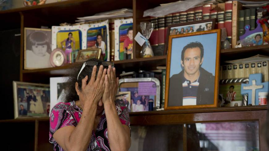 Bitter loss: A woman weeps next to a portrait of her son, who was kidnapped and murdered, in Yautepec, Mexico, on Feb. 5.