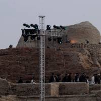 Commanding view: Pakistani security officials visit the ancient ruins of Moenjodaro, a UNESCO World Heritage site around 425 km north of Karachi, on Saturday, the first day of a festival to commemorate Pakistan's cultural heritage. | AFP-JIJI