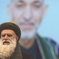 Former warlord campaigns to fill Karzai's shoes