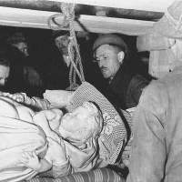 George Stout (second from right) and others remove Michelangelo's Bruges Madonna from a salt mine in Altaussee, Austria, in July 1945. | NATIONAL ARCHIVES AND RECORDS ADMINISTRATION