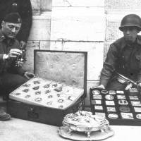 Spoils of war: James Rorimer (left) and Sgt. Antonio Valim examine art objects found in 1945 at Neuschwanstein Castle in Germany that had been stolen from the Rothschild collection in France by Nazi forces. | AP