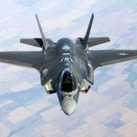 U.S. charges on with F-35 project despite costs, delays