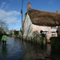 Flood-hit Britons fear worse to come