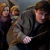 Twin souls, and Ron: Emma Watson, Daniel Radcliffe and Rupert Grint (rear) are shown as Hermione, Harry and Ron in 'Harry Potter and the Deathly Hallows: Part 2.' | AP