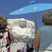 People view the new Martin Luther King Jr. Memorial in Washington in August 2011. | AP