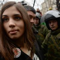Nadezhda Tolokonnikova, of the punk rock band Pussy Riot, stands outside a Moscow court Monday during a protest against the trial of eight people accused of instigating mass riots after an opposition rally in the capital on the eve of Vladimir Putin's 2012 inauguration. | AFP-JIJI