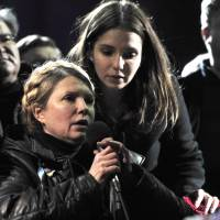 With her daughter, Yevgenia, at her side, Yulia Tymoshenko speaks in Kiev's Independence Square on Saturday. | AFP-JIJI