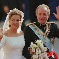Fairy-tale beginning: Princess Cristina is escorted to the Barcelona cathedral by her father, Spanish King Juan Carlos, for her wedding to Inaki Urdangarin on Oct. 4, 1997. | AP