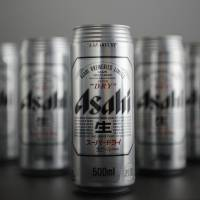Cans of Asahi Breweries Ltd. Asahi Super Dry beer are arranged for a photograph in Kawasaki. | BLOOMBERG