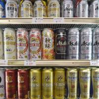 Cans of various beer brands produced by Kirin Brewery Co., Asahi Breweries Ltd. and Sapporo Breweries Ltd. are displayed last month in a liquor store in Kawasaki. | BLOOMBERG