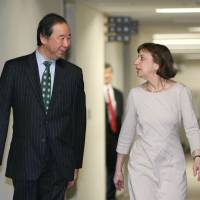 Hiroshi Oe, Japan's deputy chief negotiator for the Trans-Pacific Partnership, walks with acting Deputy U.S. Trade Representative Wendy Cutler before their talks in Tokyo on Tuesday. | KYODO