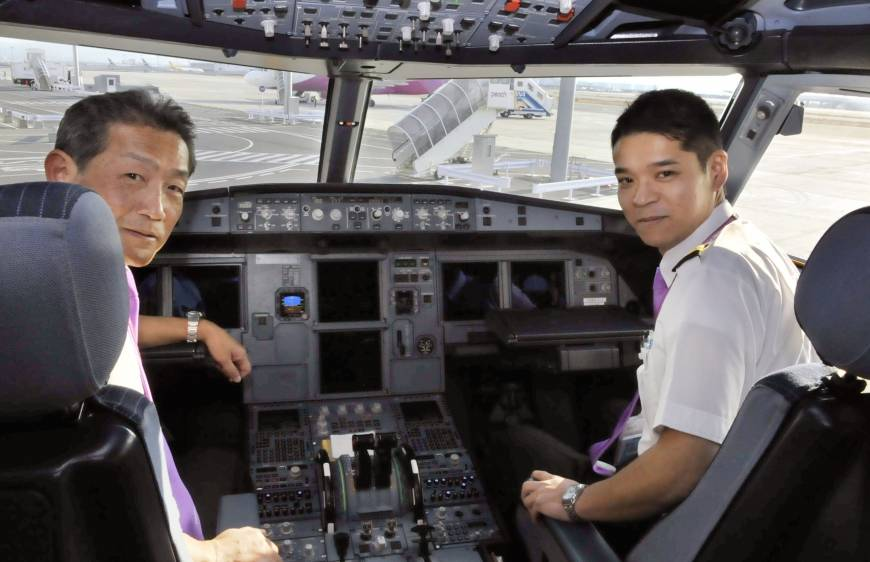 Earning his wings: Ryoji Fujii (right), a ...