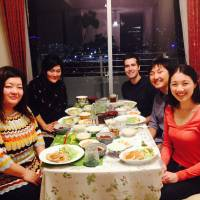 Global cuisine: Hosts Miwa Ando and Naoko Kubo prepare a home-cooked Japanese meal for Australian guests Justin Mencel, Yang Du and Amy Pun as part of the nonprofit service Nagomi Visit. | ANGELA ERIKA KUBO
