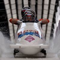 The quest for gold: (From front) Russia-1 four-man bobsleigh, pilot Alexander Zubkov, pushman Alexey Negodaylo, pushman Dmitry Trunenkov and brakeman Alexey Voevoda secured the title on the final day of the Sochi Olympics on Sunday. | AFP-JIJI