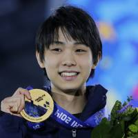 Only one: Figure skater Yuzuru Hanyu captured Japan's only gold medal at the Sochi Games. | AP