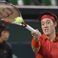 Survival of the fittest: Kei Nishikori plays a shot in his Davis Cup reverse singles match against Canada's Frank Dancevic on Sunday. Japan won the tie 3-1 after Dancevic withdrew injured. | AFP-JIJI