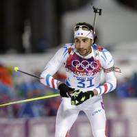 Hot shot: France's Martin Fourcade approaches the shooting range during the men's 20-km individual biathlon at the Sochi Olympics on Thursday. | AP
