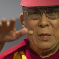 The Dalai Lama speaks at the American Enterprise Institute during a panel discussion in Washington on Thursday. | AFP-JIJI