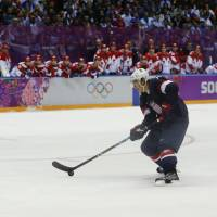 Country first: U.S. forward T.J. Oshie prepares to take a shot against Russia goalie Sergei Bobrovski during the shootout at the Sochi Olympics on Saturday. | AP