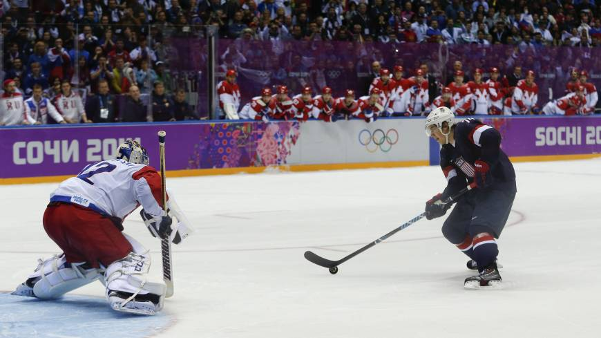 Country first: U.S. forward T.J. Oshie prepares to take a shot against Russia goalie Sergei Bobrovski during the shootout at the Sochi Olympics on Saturday.