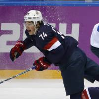 Hard knocks: T.J. Oshie of the United States falls to the ice after a challenge with Finland's Sakari Salminen on Saturday. | AP