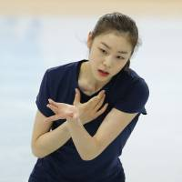 Working on the elements: Yuna Kim, the reigning Olympic champion, skates during a practice session on Monday in Sochi, Russia. The two-day competition starts on Wednesday. | AP