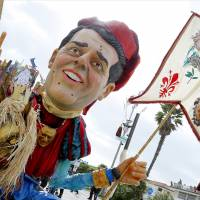 A giant effigy of political leader Matteo Renzi named 'Lo Renzi Il Magnifico' is paraded through the streets during the carnival in Viareggio, north of Tuscany, on Sunday. | AFP-JIJI