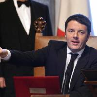 Italy's new premier sets to work amid ailing economy