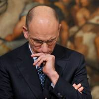 Letta of resignation: Italian Prime Minister Enrico Letta attends a joint news conference with the European Council president at Palazzo Chigi in Rome on Dec. 4. Letta on Thursday announced his resignation after the leadership of his center-left Democratic Party voted in favor of an urgent change of government to push through reform. | AFP-JIJI
