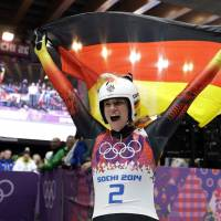 Never in doubt: Natalie Geisenberger celebrates after winning gold in the women's luge on Tuesday. | AP