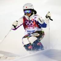 Back in action: Aiko Uemura, a five-time Olympian, competes in the freestyle skiing moguls qualifications at Rosa Khutor Extreme Park on Thursday in Sochi, Russia. | AFP-JIJI