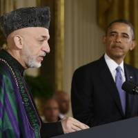 U.S. President Barack Obama and Afghan President Hamid Karzai speak at a joint news conference at the White House in January 2013. Obama has ordered the Pentagon to plan for a full withdrawal of U.S. forces from Afghanistan by the end of 2014 should Karzai's government refuse to sign a bilateral security agreement, White House sources said Tuesday. | AP