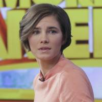 Grim outlook: Amanda Knox prepares to leave the set following a television interview Friday in New York. | AP