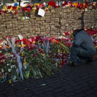 Flowers are laid at a barricade in Kiev's Independence Square on Monday to honor protesters who died in Ukraine's political unrest. | AP