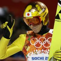 No stopping yet: Veteran ski jumper Noriaki Kasai gestures to the crowd after his first jump during the men's normal hill ski jumping final at the Sochi Olympics on Sunday. | AP