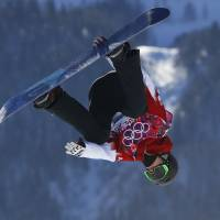 Topsy-turvy: Canada's Max Parrot takes a jump during the men's snowboard slopestyle qualifying on Thursday in Krasnaya Polyana, Russia. | AP