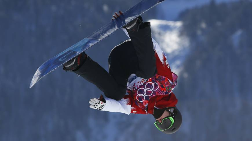 Topsy-turvy: Canada's Max Parrot takes a jump during the men's snowboard slopestyle qualifying on Thursday in Krasnaya Polyana, Russia.