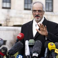 Obstructing justice?: Syrian government negotiator Bashar Jaafari speaks to the media during a conference after the second round of peace talks between the government and the opposition ended in Geneva, Switzerland, on Saturday. The talks produced little concrete relief from the conflict, and U.N.-Arab League mediator Lakhdar Brahimi said he was 'very sorry' to the Syrian people for this failure. | AP
