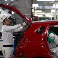 Employees work at a new multibillion-dollar Honda plant in Celaya in the Mexican state of Guanajuato on Friday. Mexico is on track to overtake Japan and Canada and become the United States' No. 1 source of imported cars by the end of next year, analysts say. | AP