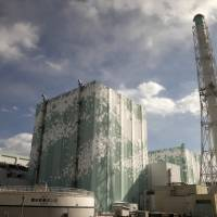 Sole survivors: The buildings for reactors No. 6 (left) and No. 5 are shown to the media during a tour of Tokyo Electric Power Co.'s aging meltdown-stricken Fukushima No. | 1 POWER PLANT IN FEBRUARY 2012.BLOOMBERG